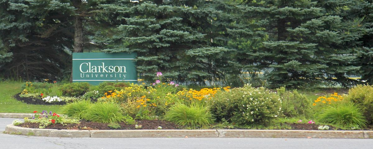 "Clarkson University Entrance. Image courtesy of <a href=""https://commons.wikimedia.org/wiki/File:Clarkson_University_entrance.jpg"" title=""via Wikimedia Commons"">Royalbroil</a> / <a href=""https://creativecommons.org/licenses/by-sa/4.0"">CC BY-SA</a>"